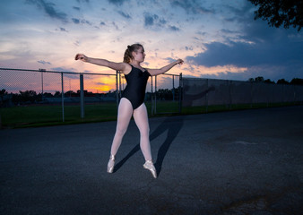 Young Tween Caucasian Girl practices Ballet in her Backyard