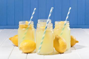 Lemonade jars on the white wood table.