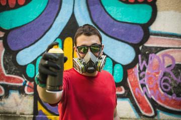 Graffiti artist holding spray color can