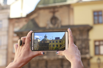 Woman tourist take picture on the smartphone