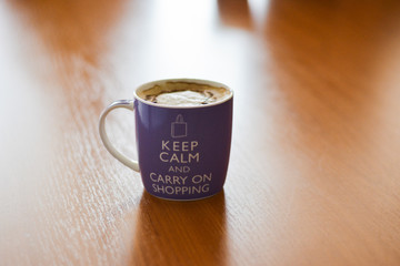 One big cup of cappuccino, white milk coffee in the morning: keep calm and carry on shopping concept