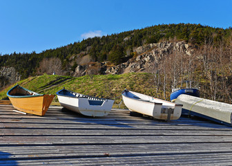 stunning image of boats pulled ashore on wharf in summer