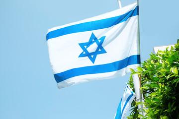 Flag of Israel on sky background