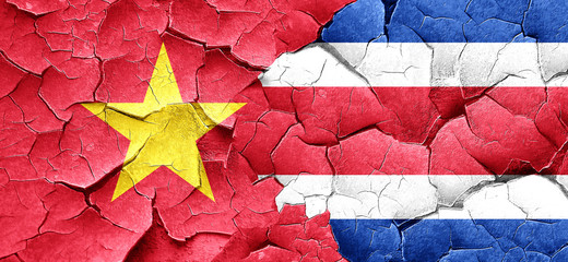 Vietnam flag with Costa Rica flag on a grunge cracked wall