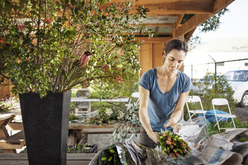 Smiling young woman working in garden store