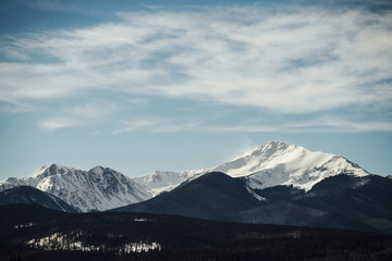 Majestic view of snowcapped mountains against cloudy sky Wall mural