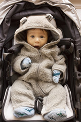 Portrait of baby boy in carseat