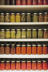 Pickle jars arranged on shelves at market