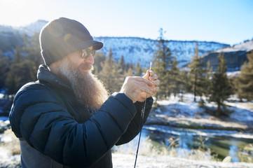 Mature man holding fishing rod