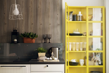 Yellow cabinet by kitchen counter at home