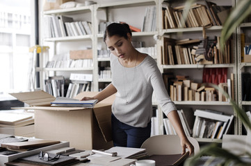 Woman examining files in office