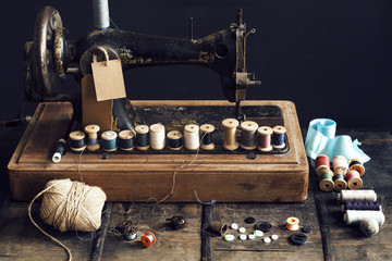 Vintage sewing machine with colorful thread spools