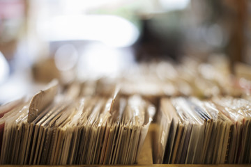 Stack of various records in box