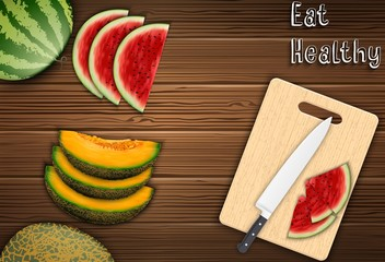 Fresh fruits slices on the table with a knife and watermelon on a cutting board background