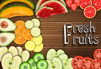 Fresh fruits slices on the table background