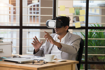 indian male using virtual reality technology at work
