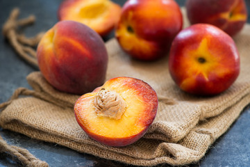 Peaches and nectarines on rustic napkin