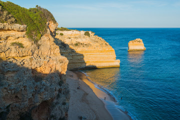 Lovely evening with a view of the ocean and cliffs. Praia da Marina. Region Algarve. Portugal