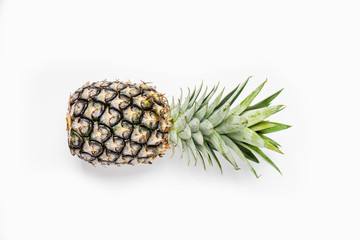 Top view of pineapples on wooden table over white background