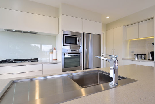 A modern white kitchen with appliances