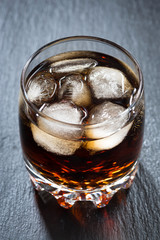 cola with ice in a glass, vertical top view