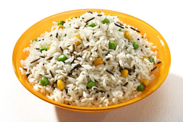 Dish of black & white rice in an orange plate  on white background. Close up, high resolution product.