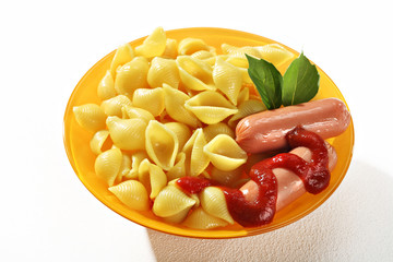 Cooked macaroni shells with sausages and sauce in orange plate on white background. Close up, high resolution product.