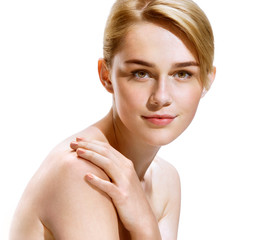 Beautiful girl with natural make up, looks at camera. Photo of attractive blonde girl on white background. Youth and skin care concept
