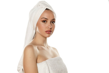 beautiful young woman with a towel on her head