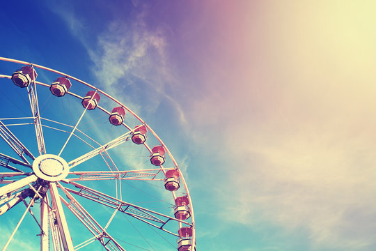 Vintage stylized ferris wheel at sunset.