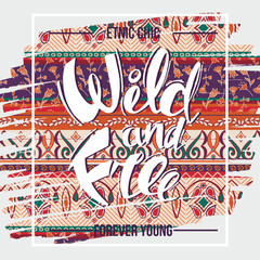 Hand drawn lettering of a phrase wild and free on decorative bac