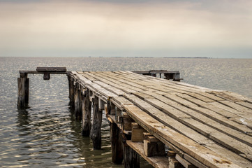Wooden jetty leading to the sea