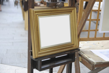 Old easel with a gilded frame