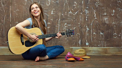 Young woman acoustic guitar play.