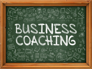 Business Coaching - Hand Drawn on Chalkboard. Business Coaching with Doodle Icons Around.