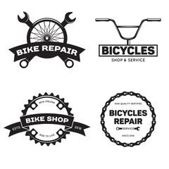 Set of vintage and modern bike shop logo badges and labels.