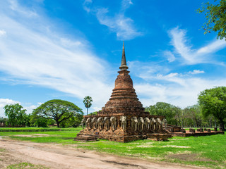 An ancient sandstone pagoda with Elephant Sculptures at the base of Pagoda in Sorarak Temple, Sukhothai Historical Park, Thailand