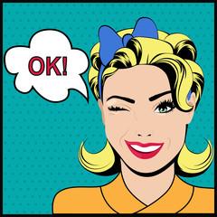 Pop art winking woman saying ok and speech bubble.