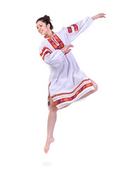 jumping girl in polish national traditional costume, full length portrait against isolated white background