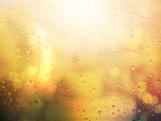 Abstract raindrop on glass window with warm filter and copyspace
