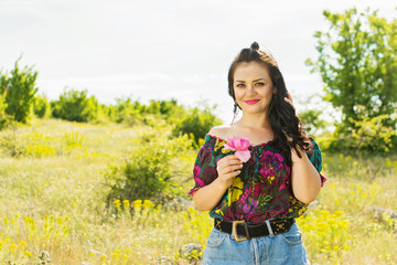 Gorgeous young woman in nature in summer