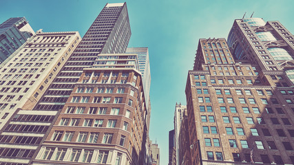 Retro stylized photo of buildings in the New York City, USA.