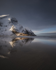 Winter mountain reflection on Bunes beach, Norway
