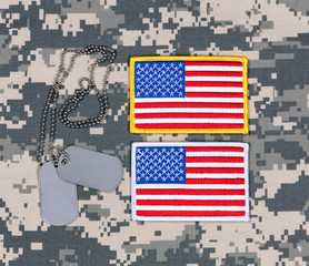 Small USA flag patches and ID tags on military  uniform