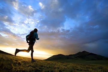 Trail runner at sunset