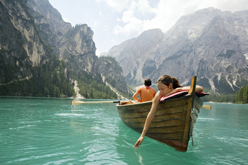 Couple in a row boat on the azure Lago di Braies