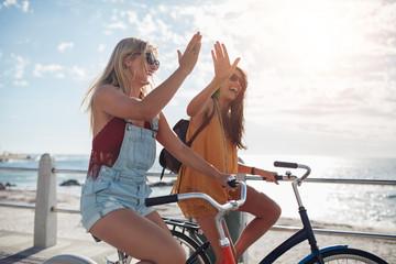 Best friends enjoying riding bicycles