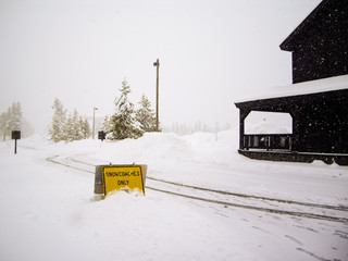 Snowcoaches Only Sign in snowstorm Yellowstone