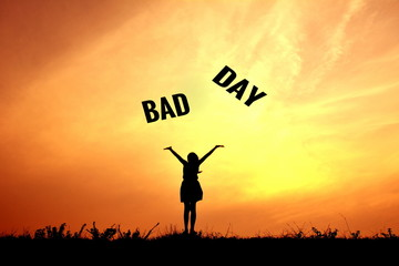 Silhouette children and bad day word at sky sunset