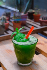 Lime mint smoothie on wooden table